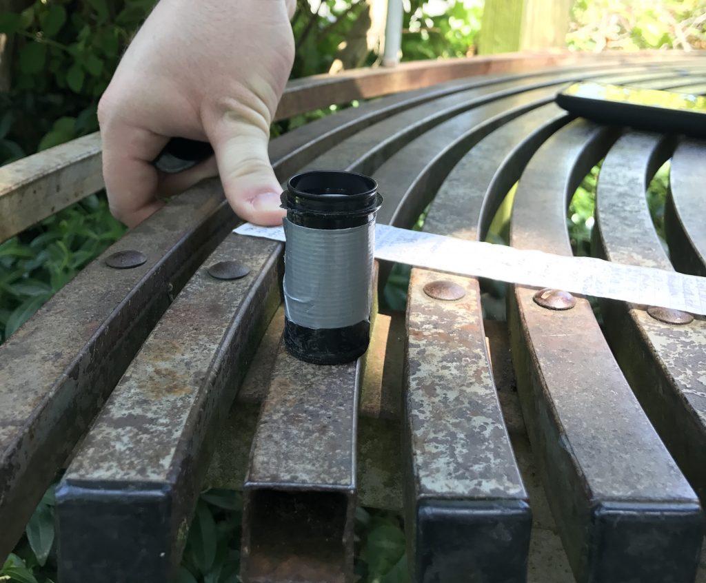 Geocache under a bench