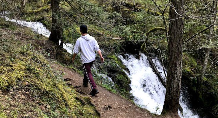Walking by Cascade Falls in Moran State Park